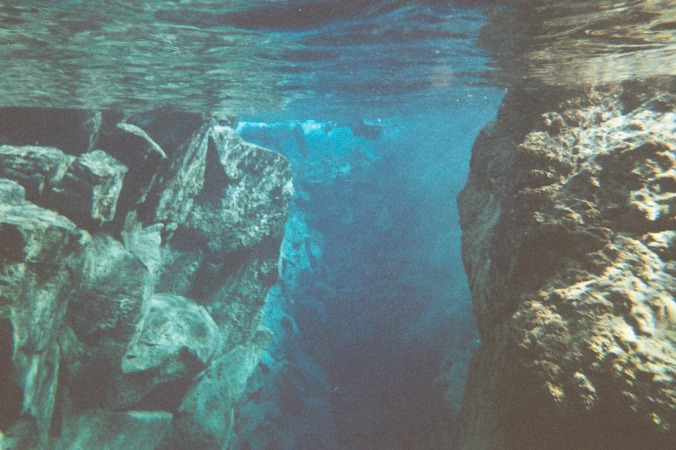 Snorking in Silfra, a fissure between the North American and Eurasian techtonic plates. Located in Þingvellir National Park (B)