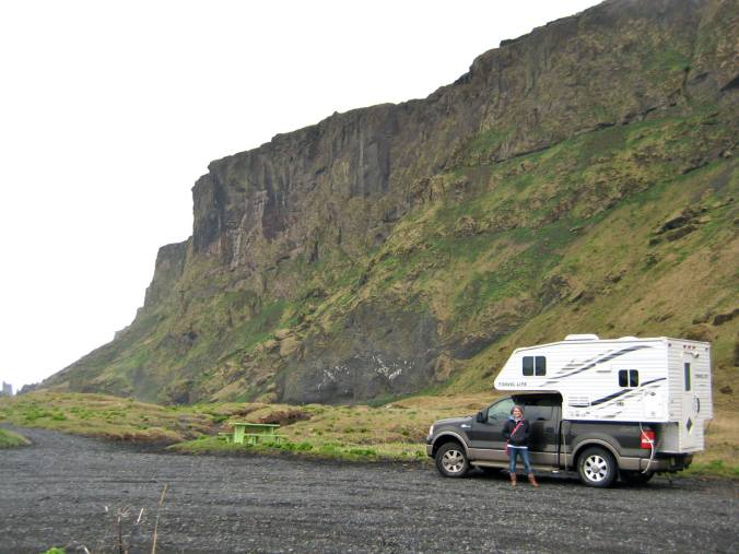 Alexis and our new truck at Reynisdrangar beach (J)
