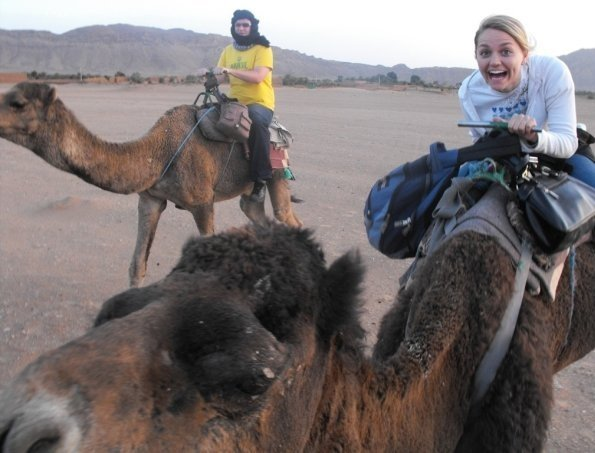 Riding a camel in the Sahara desert in Morocco