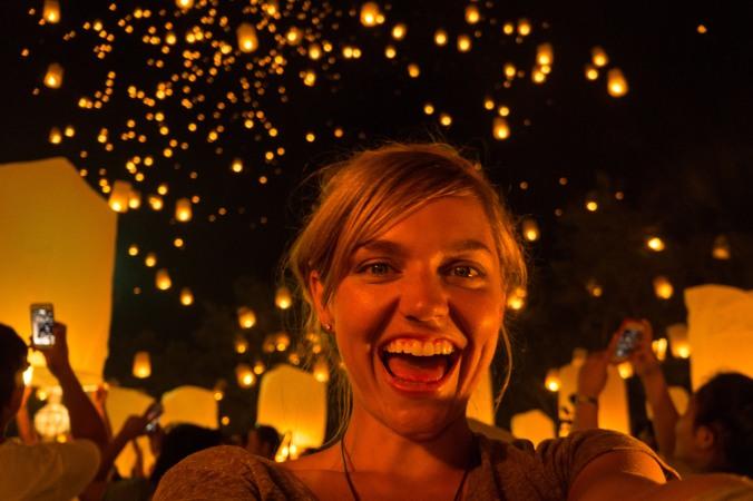 Smiling selfie with lanterns in the sky at Chiang Mai, Thailands Yi Peng/Loi Krathong lantern