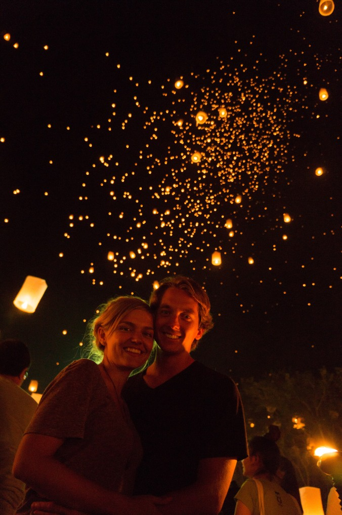 Alexis and David Rose stand beneath thousands of lanterns in Chiang Mai, Thailand's night sky during Yi Peng/Loi Krathong