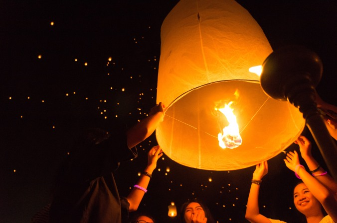 A group of festival goers holds onto their lantern before releasing it at Chiang Mai, Thailands Yi Peng/Loi Krathong festival