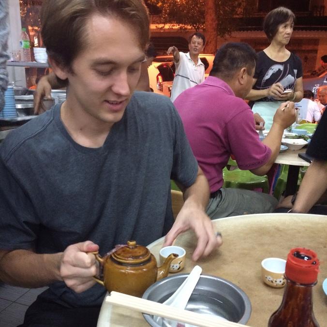 Man pours tea at Syarikat Yu Kee in Kota Kinabalu, Malaysia