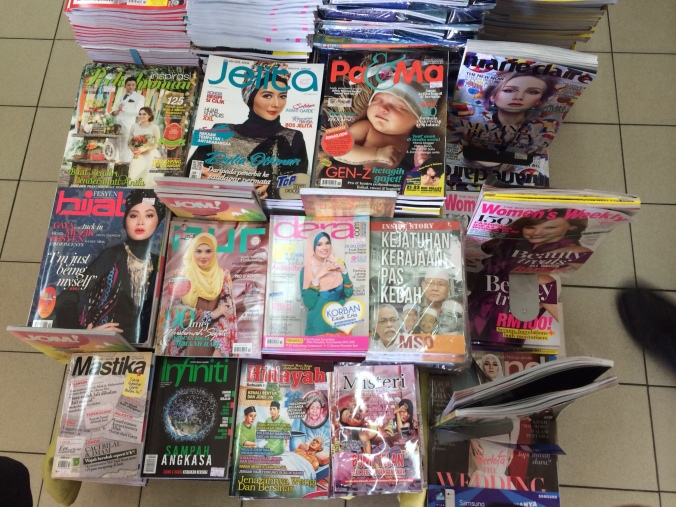 Malaysian magazines feature women wearing modest head scarves
