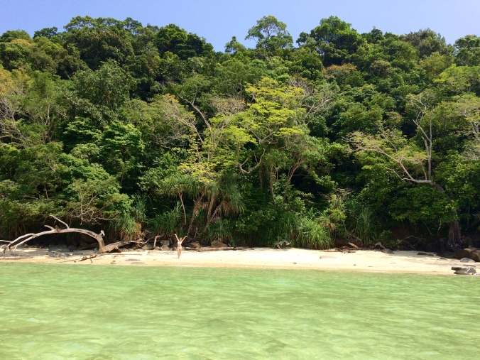 Alexis poses on a secluded and jungle-lined beach on the south side of Sapi island