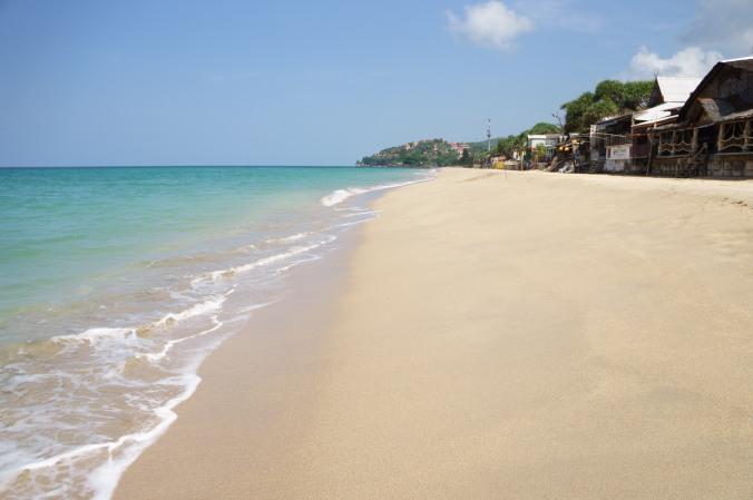 Turquoise waters, wooden bungalows, and white sand line Klong Nin Beach, Ko Lanta, Thailand