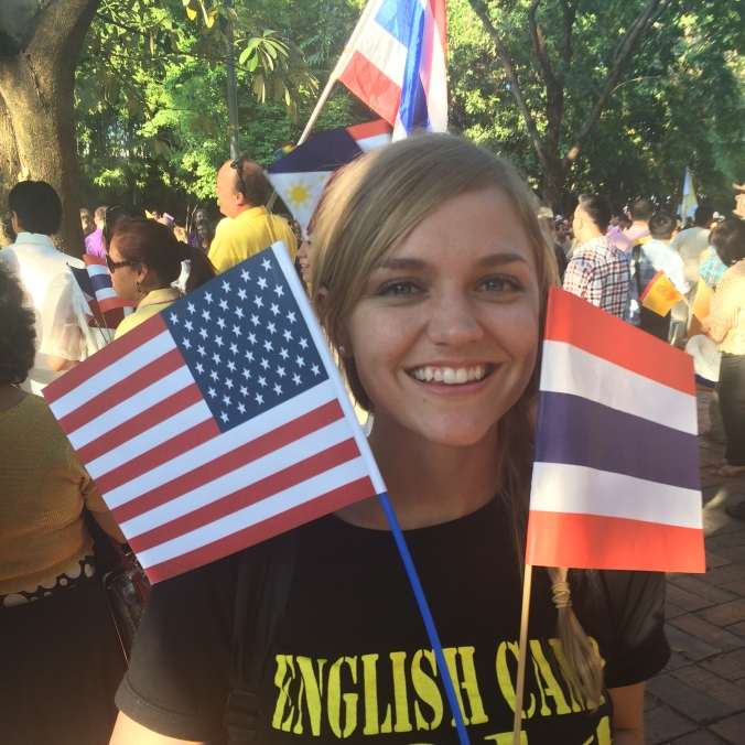 Alexis holds up Thai and American flags