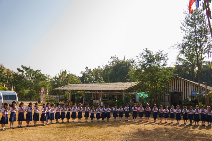 Scouts stand in a circle at a camp in Chiang Mai, Thailand