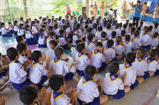 Students clap and perform at a scout camp in Chiang Mai, Thailand