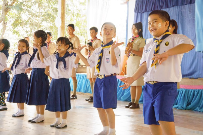 Students dance at a scout camp in Chiang Mai, Thailand