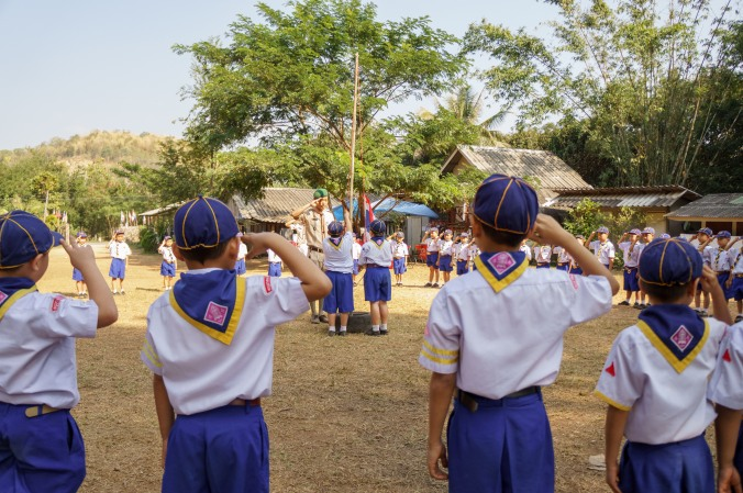 Boy scouts salute the Thai flag in closing ceremony